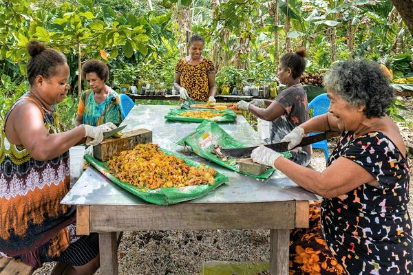 Women working on nutritional projects, part of an education programme to prevent NCDs by promoting a healthy diet.