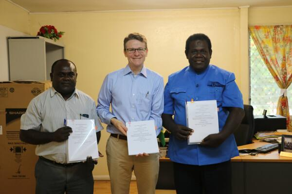 Australian High Commissioner Rod Brazier (middle) with Permanent Secretary MOFT, Harry Kuma (left)  and A/g Permanent Secretary MHMS, Arnold Moveni (right) after signing an agreement committing Australia to a new phase of support to the Solomon Islands health sector.