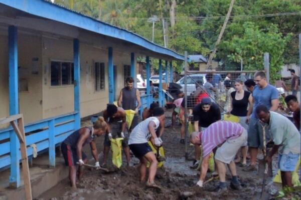 For six hours, the White Demons and their Australian friends including the Australian High Commissioner shoveled nearly 200 bags of mud and put on a BBQ breakfast for the community.