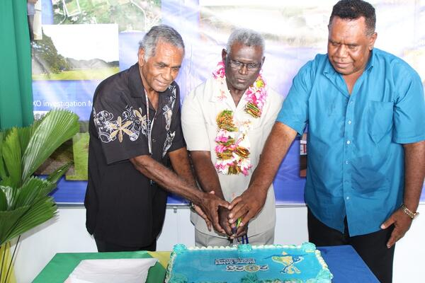 PM Sogavare, NHA chairman and PG2023 subcommittee chairman cuts the cake to mark the opening.