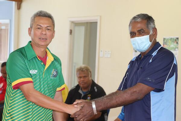 President of the Solomon Islands Football Federation (SIFF) Willie Lai (L) and Chairman of the National Hosting Authority (NHA) Dr. Jimmie Rodgers at the handover ceremony.