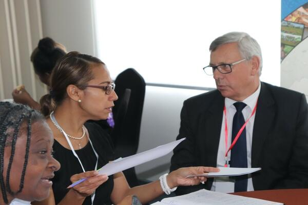 Mr. Howard Lawry, Public Solicitor (right) discusses with Andie Driu, Prosecution Advisor of Police Prosecutions Department RSIPF.