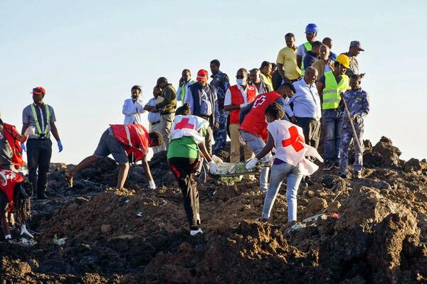 Rescue workers at the site of Ethiopia Airlines Flight 302 crash on Sunday, where more than 150 people were killed.