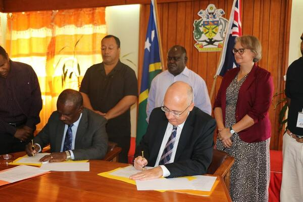 Minister for Foreign Affairs & External Trade, Hon. Jeremiah Manele and Australian High Commissioner Dr Lachlan Strahan sign the funding agreement.